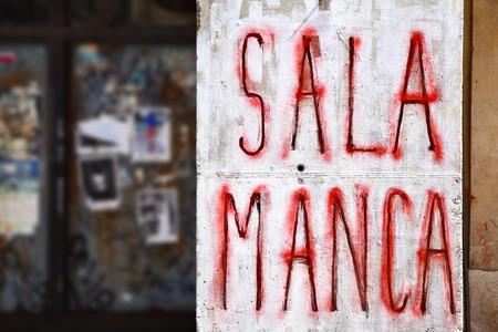graffito: Salamanca - Urban graffiti on a wall close-up, Spain
