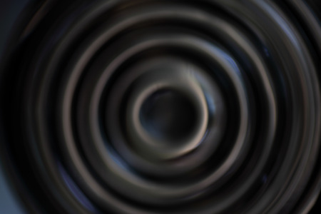 sombre: Black abstract background with defocused concentric circles