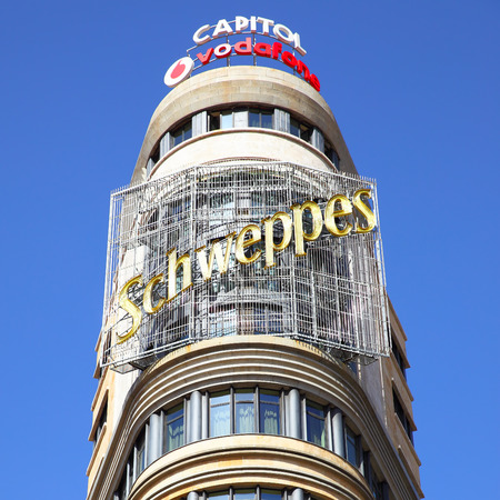MADRID, SPAIN - September 06, 2016: Top of the Capitol building with neon sign in Madrid Editorial