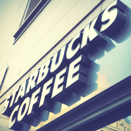 shop sign: MADRID, SPAIN - September 06, 2016: Starbucks coffee shop sign close-up. Retro syle filtred image
