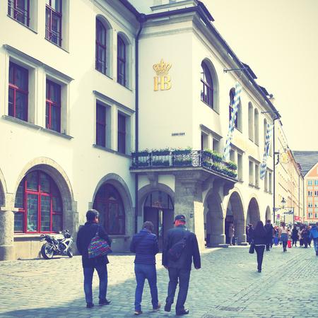 alehouse: MUNICH, GERMANY - MAY 18, 2016: People near Hofbraeuhaus beerhouse in Munich. Retro style filtred image