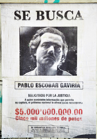 pablo: MADRID, SPAIN - September 01, 2016:  Promotional poster for TV series Narcos (Wanted Pablo Escobar Gaviria, prize 5 billions pesos) in Madrid