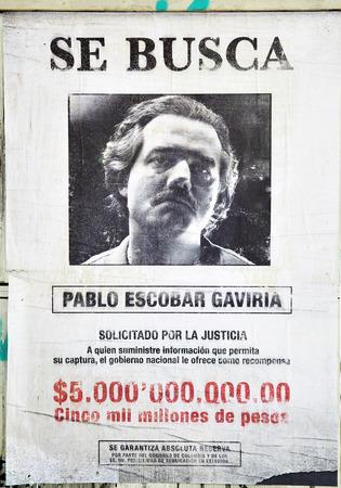 billions: MADRID, SPAIN - September 01, 2016:  Promotional poster for TV series Narcos (Wanted Pablo Escobar Gaviria, prize 5 billions pesos) in Madrid