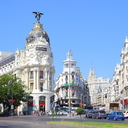 traffic building: MADRID, SPAIN - September 01, 2016: Road traffic near Metropolis building in Madrid