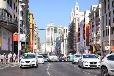 traffic building: MADRID, SPAIN - September 06, 2016: Road traffic on Gran Via near the Capitol building in Madrid Editorial