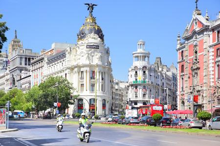 traffic building: MADRID, SPAIN - September 01, 2016: Road traffic near Metropolis building on the corner of Calle de Alcala and Gran Via in Madrid