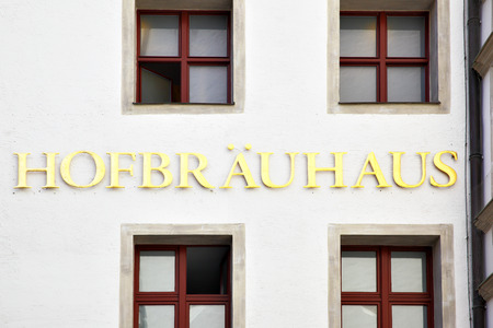 beerhouse: MUNICH, GERMANY - MAY 18, 2016: Signboard of Hofbraeuhaus beerhouse in Munich