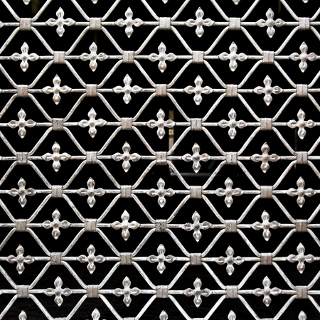 to grate: Old forged grate in Budapest, Hungary - architecture detail