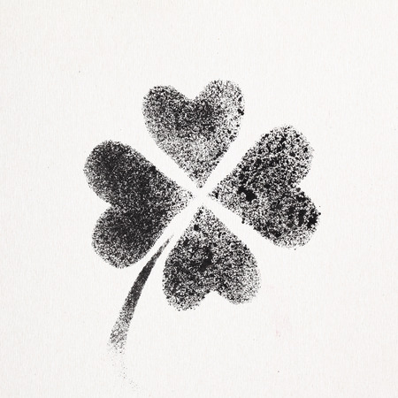 stenciled: Stenciled four-leaf Irish clover - graffiti style raster illustration Stock Photo