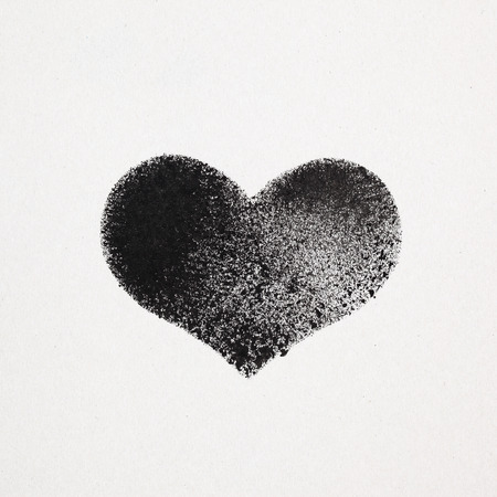 stenciled: Black stenciled heart on gray cardboard Stock Photo