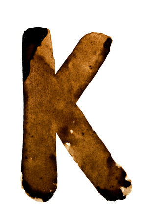 pictured: Letter K - alphabet in coffee