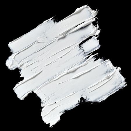 Witte olieverf getextureerde penseelstreken geïsoleerd op zwarte achtergrond Stockfoto