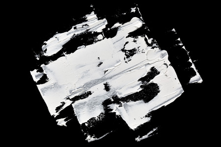 brush painting: White abstract brush strokes isolated on black background