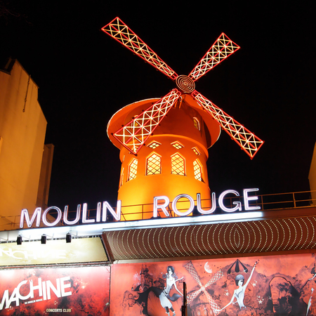 illuminated: Paris, France - March 04, 2011: The Moulin Rouge (Red Mill) cabaret at night in Paris, France