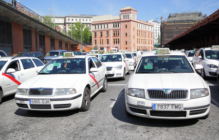 Madrid, Spain - May 10, 2012: Lots of white taxis near Atocha train station in Madrid Editorial