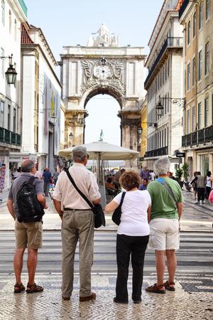sightseeng: Lisbon, Portugal - May 14, 2012: Tourists near Rua Augusta arch in Lisbon