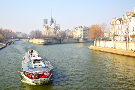 Paris, France - March 05, 2011: Seine river and  Notre Dame de Paris in spring Editorial