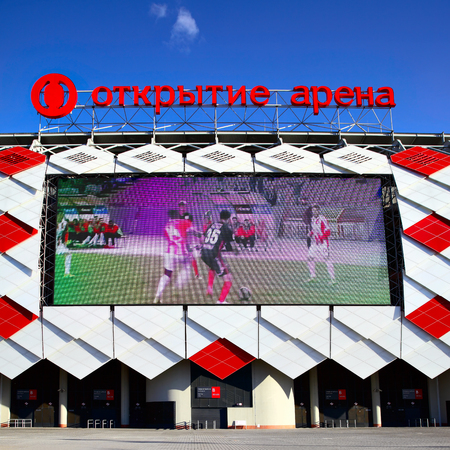 Moscow, Russia - May 03, 2017: Facade of Otkrytie Arena Stadium (Spartak Stadium) with big screen in Moscow Editorial