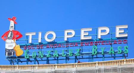 pepe: Madrid, Spain - September 06, 2016: Vintage Tio Pepe advertisement at Puerta del Sol in Madrid