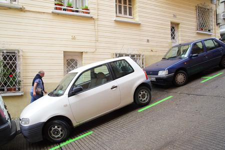 slantwise: Barcelona, Spain - June 10, 2011: Uphill street with parking lot on a slant in Barcelona