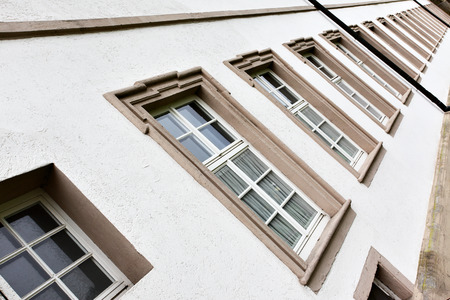 comfortableness: Perspective of windows in a row, Germany Stock Photo