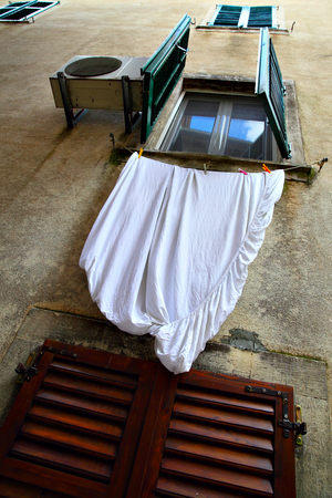 jalousie: Window with drying linen, Old town of Kotor, Montenegro Stock Photo