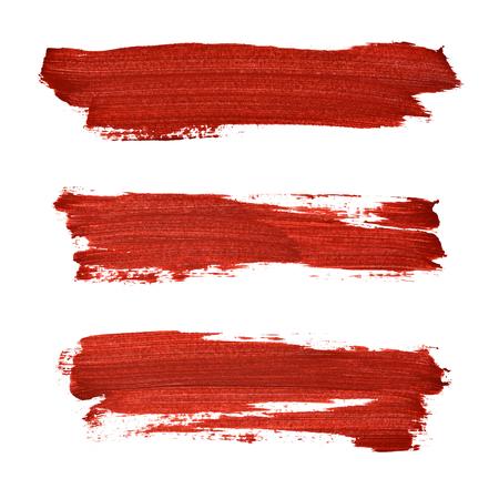 Penseelstreken van rode acrylverf geïsoleerd op de witte achtergrond