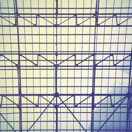 ceiling: Lattice frame of vintage skylight window -  industrial architectural background.  Retro style filtered image