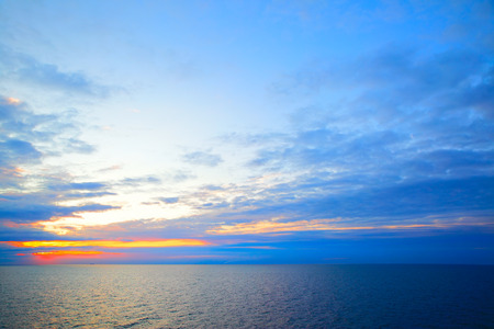 Beautiful sundown in Sweden flag colors - seascape with sea horizon, may be used as background. Stock Photo