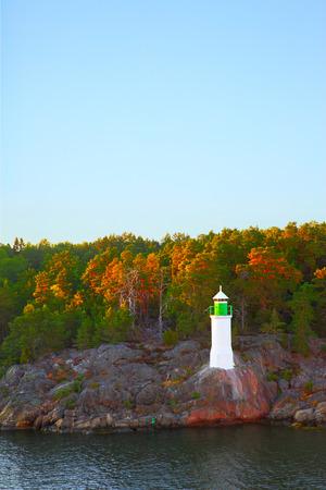 Swedish landscape - Coast of small island ind Baltic Sea with lighthouse