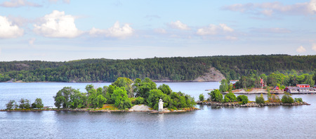Scandinavian landscape with islands and small lighthouse, Sweden