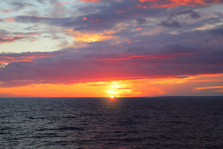 expanse: Sundown over sea - scenic sunset seascape with sea horizon and colorful clouds Stock Photo