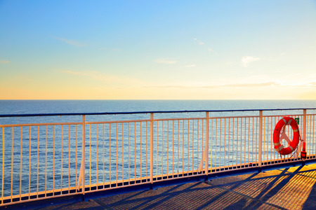Promenade open deck on a cruise ship at sunset