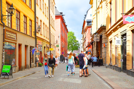 Stockholm, Sweden - July 25, 2017: Tourists in Stora Nygatan street in Gamla Stan in Stockholm