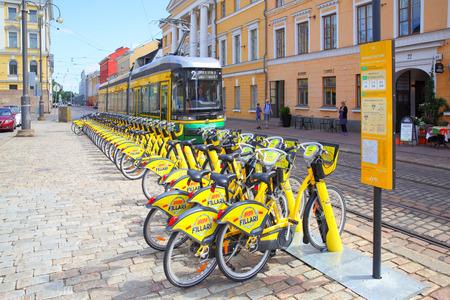 Helsinki, Finland - July 26, 2017: Tram and rental bicycle parking lot in Helsinki Editorial