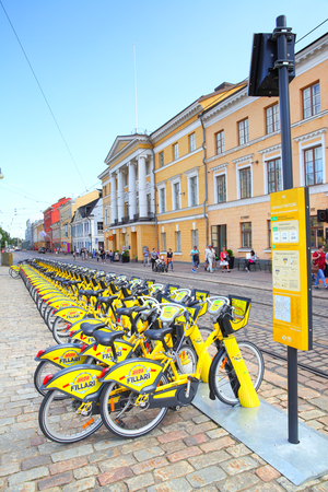Helsinki, Finland - July 26, 2017: Yellow bikes at the rental bicycle parking lot in Helsinki Editorial