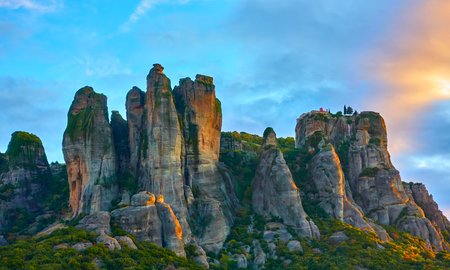 Beautiful picturesque view of rocks and St. Stephen monastery on the top at sunrise, Meteora, Greece Stock Photo