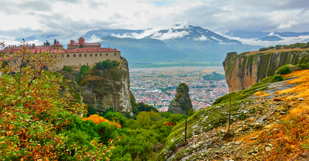 View of St. Stephen monastery on the top of rock in Meteora in the autumn, Greece