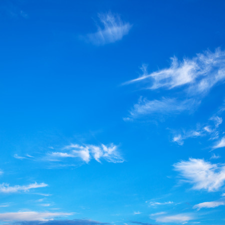 Blue sky with light clouds, may be used as background. Square cropping