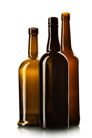 Three empty wine bottles isolated over the white background