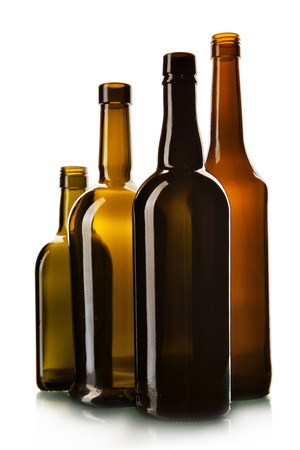 Empty wine bottles isolated over the white background