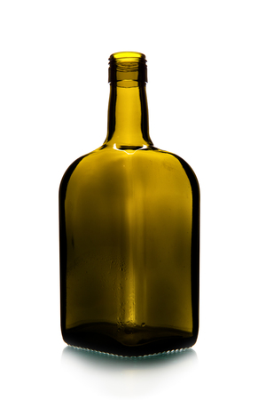Empty short glass bottle isolated over the white background