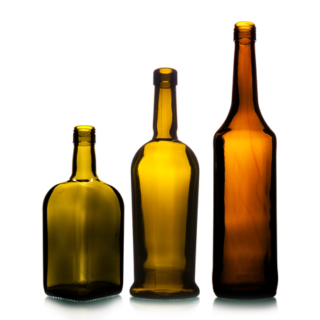 Empty wine bottles in a row isolated over the white background