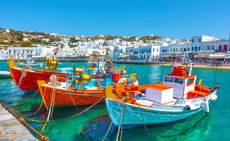 Port with old fishing boats and the waterfront in Mykonos Islang, Greece