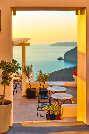 View of seashore through open door in Santorini Island, Greece Banco de Imagens
