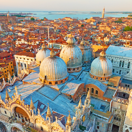 Domes of The Cathedral Basilica of Saint Mark in Venice in the evening, Italy. Wide angle shot