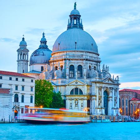 The Grand Canal and Santa Maria della Salute church in Venice in the evening, Italy