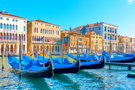 The Grand Canal in Venice with moored gondolas on sunny summer day, Italy