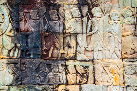 Ancient khmer stone carving in Angkor Thom in Cambodia Imagens