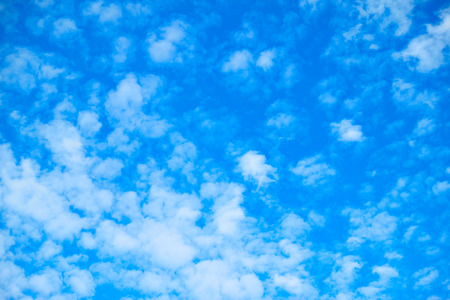Blue sky with white fleecy clouds, may be used as background 写真素材